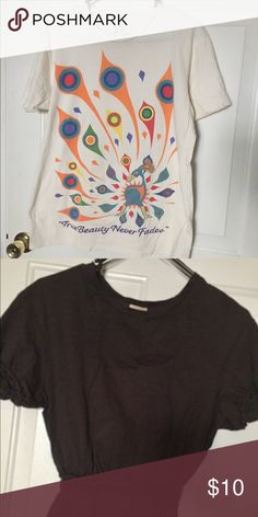 """2 cute shirts one by suite 230 one by H&M M One shirt by suite 230 which says """"True Beauty never fades"""" size M and one by H& M in size 8. Has braided like part at the waist and on the sleeves. H&M Tops"""