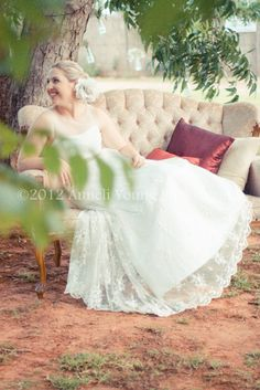Beautiful Bride under the tree during the vintage wedding reception at The Grand, Patensie, Eastern Cape, SA