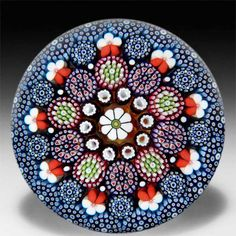Mike Hunter 2014 close concentric millefiori with a central daisy and pansy canes paperweight. by  Twists Glass Studio