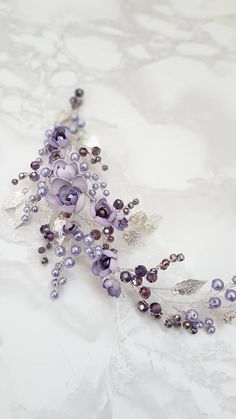 This beautiful handmade bridal hair piece made with purple crystals, silver tiny leaves, handcrafted violet flowers and lavender glass pearls. Complement most wedding hairstyles. It is the perfect bridal headpiece for that woman who wants to simply sparkle on her wedding day. ♥ Size approx