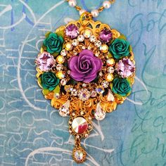 http://www.etsy.com/listing/70451100/stunning-purple-and-teal-crystal-pendant