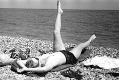 The candid shots of Miller picture her sunbathing topless on a beach in Antibes. Roland Penrose Estate, England 2013. The Penrose Collection. All rights reserved