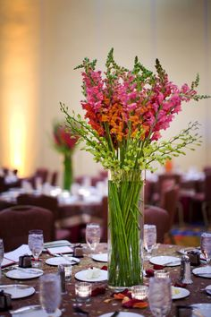 Pink and orange snapdragon centerpiece - wedding photo by Melissa Jill Photography