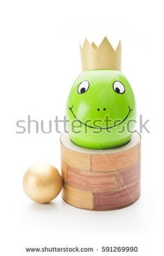 easter egg painted like the fairytale prince frog with a crown
