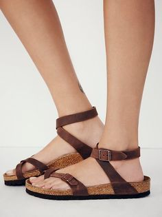 Yara Birkenstock | Elegant sandal with an adjustable ankle strap and toe loop. Features the Birkenstock classic footbed and shock-absorbing EVA sole. Flirty, fashionable, and fun.