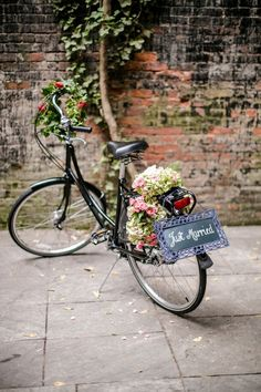 Flower adorned 'getaway' bike / http://www.himisspuff.com/bicycle-wedding-ideas/5/