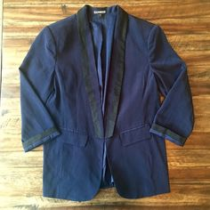 Express Navy Boyfriend Fit Blazer Super comfy relaxed fit blazer. True navy with black detail. Looks very professional but can also be dressed down with jeans. The size is zero but I feel like this would comfortably fit someone he wears either an extra small or a small due to the relaxed fit. Feel free to make me an offer! Express Jackets & Coats Blazers