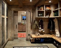 Love this mud room with barn wood, tile floors, chalk board cabinet doors