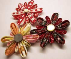 my version of fabric oragami flowers using vintage fabric and vintage buttons
