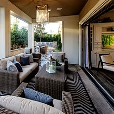 Design Tip: Make your patio inviting by adding an outdoor area rug & throw pillows. | Pulte Homes