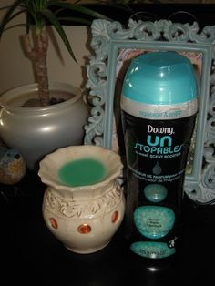 Downy Unstoppables in wax burner. i have tried these! they last ten times longer then the scents that are suppose to go in them! i put mine in over a week ago and still have to unplug it every once in a while because its strong!