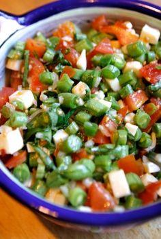 Raw green bean salad with tomatoes, fresh mozzarella and basil.