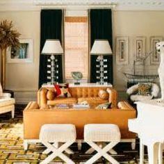 Some Very Intriguing Accents In This Room Tall Back Chair Pair Of Stools Br Gold Palm Tree Exotic White Doggie Reminiscent Like The Symmetrical