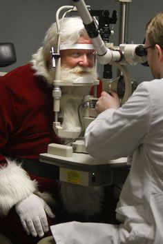A man dressed as Santa Claus visits the Southern College of Optometry in Memphis, Tennessee, where he received an eye examination