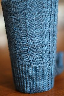 This elegant herringbone pattern is well-suited for both men's and women's socks. The firm fabric created by the herringbone motif is balanced by ribbing on either side of the leg which adds enough stretch for a great fit. Perfectly elegant for office wear while still looking great kicking back in casual clothes. Pattern now provided for cuff down and toe-up versions. Sizes: Small, medium, large.