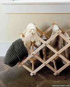 An accordion-style wine rack can double as a compact dryer for wet woolens.