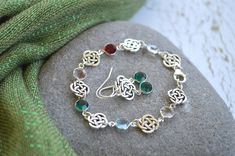 This has been one of my favorite bracelets and earrings to create and it is a pretty set that reflects your love of Ireland or Celtic heritage. This listing comes with matching custom earrings with your choice of birthstone (see last photograph for guidance). Made with round Celtic Knots and faceted Swarovski channel cut crystals, you can create a custom bracelet with a birthstone representing everyone in your family