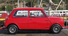This is it for me. 1964 Austin Mini with flared arches, Cosmic wheels and red paint. As my grandaddy would say : it don't get no better than this!