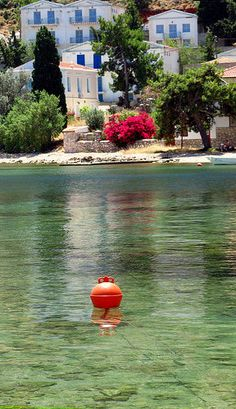 Architecture and buoy...Coastal neoclassical architecture and red buoy. Kastellorizo island, Dodecanese, Greece | Flickr - Photo Sharing!