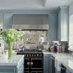 "Benjamin Moore Color...""boothbay gray."" Dusty and coastal-inspired, with a tinge of blue. And...this happens to be Jennifer Lopez's California kitchen:) Just a little FYI."