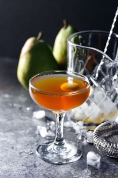 This fresh and fruity twist on a classic Manhattan cocktail recipe features pear brandy, sweet vermouth, and Angostura bitters. Garnish this perfect winter cocktail with a melon-ball of pear or a citrus twist. Mezcal Cocktails, Brandy Cocktails, Beste Cocktails, Christmas Recipes Dinner Main Courses, Easy Holiday Recipes, Winter Cocktails, Sour Cocktail, Cocktail Recipes, Drink Recipes