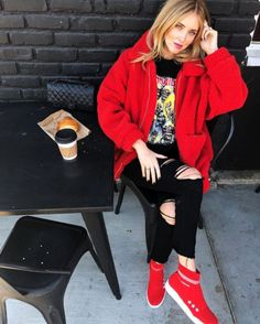 Chiara Ferragni wears a red pixie coat by I.AM.GIA and red knitwear sock sneakers by her own Chiara Ferragni Collection