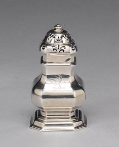 A George I Britannia standard silver caster, by Edward Wood, London Perfume Bottles, London, Wood, Silver, Woodwind Instrument, Money, Timber Wood, Wood Planks, Trees