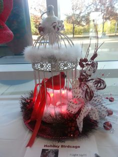 Christmas red and white birdcage for charity.