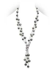 Aurora Necklace  8-10mm multi-colored Black South Sea cultured pearls with shapes ranging from spherical to teardrop, intertwined with rainbow-colored natural sapphires (2.81cts) and diamonds (2.20cts.). Set in 18k white gold