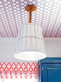 The decorating experts at DIYNetwork.com create coastal light pendant by repurposing a wood bushel basket.
