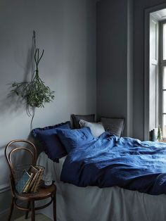 color of that comforters is so gorgeous- also, having the plant is a nice touch
