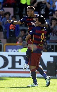 Barcelona's Uruguayan forward Luis Suarez (R) celebrates with Barcelona's Brazilian forward Neymar after scoring during the Spanish league football match Granada CF vs FC Barcelona at Nuevo Los Carmenes stadium in Granada on May 14, 2016. Barcelona sealed their 24th La Liga title as Luis Suarez took his tally for the season to 59 goals with a hat-trick in a 3-0 win at Granada to hold off Real Madrid's late-season surge.