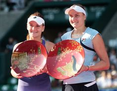 Agnieszka Radwanska of Poland runner up and Nadia Petrova of Russia winner celebrate with their plates after the womens final during day seven of the Toray Pan Pacific Open