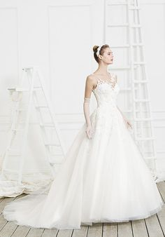Tulle ball gown wedding dress with illusion neckline and beaded lace appliqué details I Style: BL202 Hope I Beloved by Casablanca Bridal I https://www.theknot.com/fashion/bl202-hope-beloved-by-casablanca-bridal-wedding-dress?utm_source=pinterest.com&utm_medium=social&utm_content=july2016&utm_campaign=beauty-fashion&utm_simplereach=?sr_share=pinterest