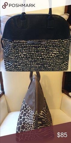 Kipling classic handheld satchel in black n white. Classic handheld satchel with lots of room and pockets to keep you organized and in Style by Kipling. Kipling Bags Satchels