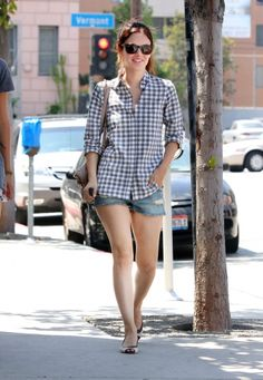 Rachel Bilson on shorts and plaid shirt.