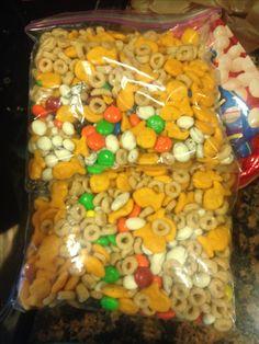 Toddler trail mix! Gold fish yogurt raisins m&ms and Cheerios