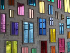 old windows ~ with colored glass.  this is an art installation but it would look cool on a fence or side of building