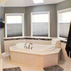 Remodeled quad cities master suite with barn door entry to for Bathroom remodel quad cities
