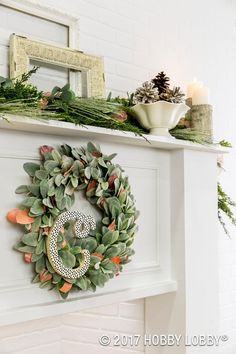 Create a stunning wreath with faux florals and a foam wreath form. Add a touch of personalization with a letter (cut from foam) covered in scrapbook paper.