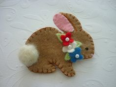 Items similar to Felted Wool Patriotic Baby Bunny With Red White Blue Flowers Pin Brooch on Etsy Felted wool bunny pin - cute pin, but also an appealing way to teach girls the blanket stitch! Felt Diy, Felt Crafts, Fabric Crafts, Bunny Crafts, Easter Crafts, Felt Christmas, Christmas Crafts, Sewing Projects, Craft Projects