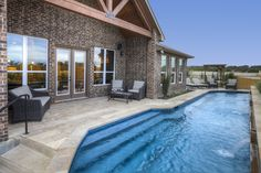 A long, rectangular pool fits a luxurious detail into a small backyard. Seen in Ridgeview, an Austin community.