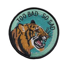 "Sometimes bad stuff happens, even to cool tigers.  3.5"" embroidered patch with merrowed edge and iron-on backing. Follow the instructions on the back to affix this patch to a garment of your choosing! For items that will be washed, sewing on is recommended."