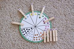 TODDLER TIME ACTIVITY: NUMBER WHEEL= Cut different colored dots out with a punch, assemble according to the included template, and laminate. Write the corresponding numbers on the clothes pins with a Sharpie marker. Good tool for practicing counting skills!