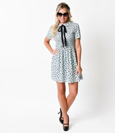 Tie and bow beauteously, dames! A choice confection, this 1960s reminiscent retro flare dress is patterned in a blue gin...Price - $68.00-Syf0CKTt