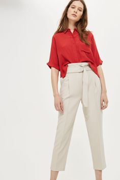 The Belt Paper Waist Peg Trousers can elevate any look. Wear with a button up shirt for work or with a talking point tee to make a statement.
