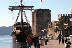 UNESCO city of Trogir port with Fortress Kamerlengo in the background.