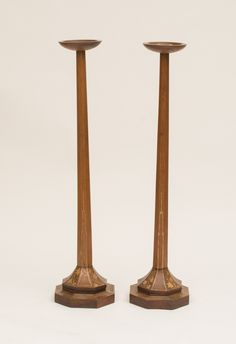 PAIR OF ENGLISH OAK AND PARCEL-GILT CANDLESTANDS, CIRCA 1930