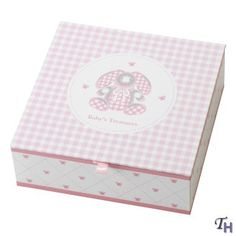 "Gingham Bunny Keepsake Box. Creatively designed with your needs in mind. Four covered compartments: First Tooth,. First Curl, First Treasures and First Photos. Includes Oval Picture Slot. 7 1/8""L x 7 1/8""W x 2 1/2""H."