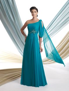 One-shoulder Georgette chiffon A-line gown with curved asymmetrical neckline, single dramatic cowl drape with rosette accent and cascading back shawl, ruched bodice features hand-beaded motif at asymmetrical Empire waistline, sweep train. Sizes: 4 – 20